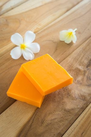 Soap set on a wooden background
