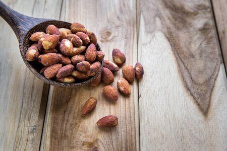 Closeup on hazelnuts on wooden background