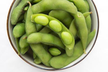 close up of Edamame soy beans on white background