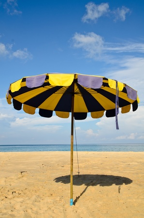 Umbrella on the sand Stock Photo