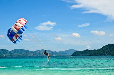 PEOPLE ARE PARASAILING in phuket photo