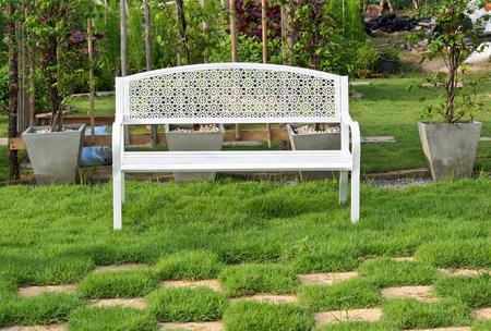 White Wooden Bench in the garden