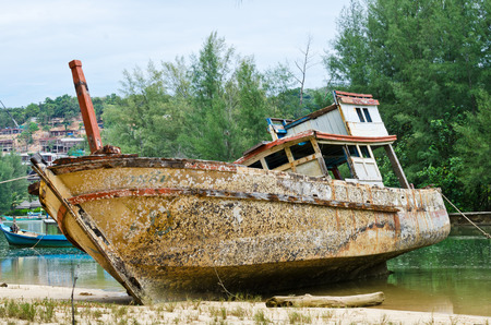 An old boat, weathered by the elements, on the beach Editorial