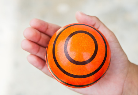 Boy hand with small ball