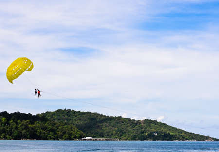 PEOPLE ARE PARASAILING in phuket beach