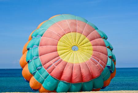 Closeup parachute for parasailingon the beach in blue sky Stock Photo