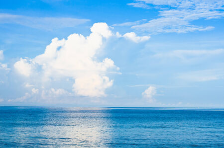 sea and clouds and blue sky on background.