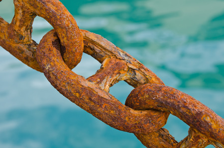 Rusty chains with sea background Stock Photo