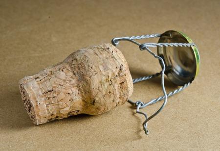 champagne cork  on wood background photo