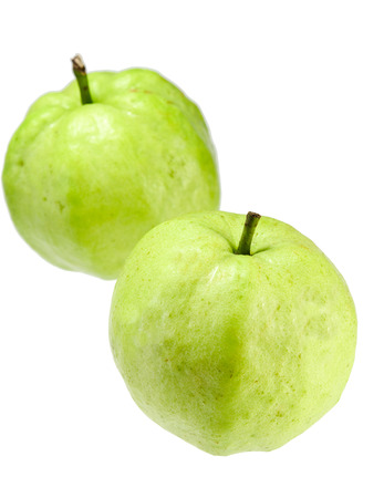 Two green guavas on the  white background Stock Photo