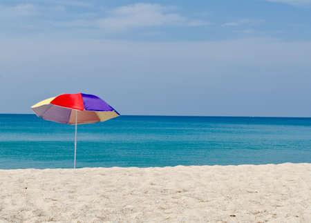Seasonal and Holidays: sun umbrella on the beach. Stock Photo