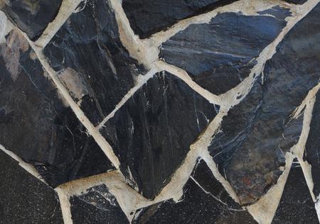 Slate stone wall textured background. Stock Photo