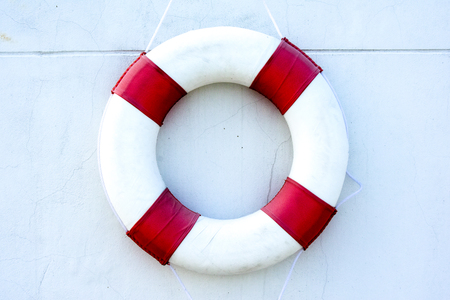lifeline: Safety equipment, Life buoy or rescue buoy floating on swimming pool to rescue people from drowning man.