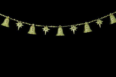 Christmas Golden bell chain on black background