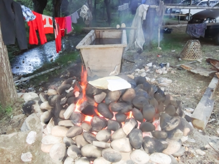 Burning stones for boiling water bath in Bhutan. photo