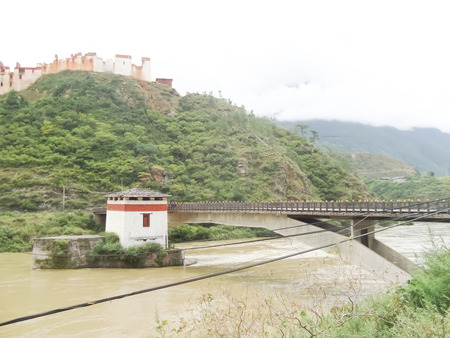 Bridge over the river in Bhutan photo