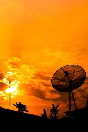 Satellite dish with  orange sky photo
