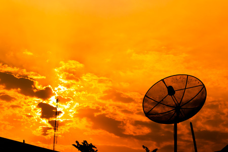 Satellite dish with  orange sky photo