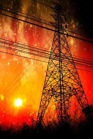 High voltage power pole middle of a cornfield with orange sky and galaxy Stock Photo