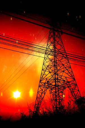 power pole: High voltage power pole middle of a cornfield with orange sky and galaxy Stock Photo