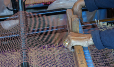 weaving: People are weaving mats