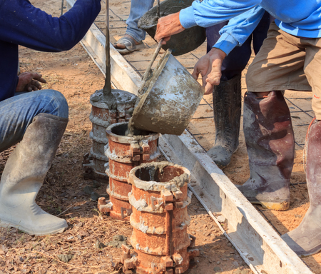 castings: Workers are cement castings for strength testing