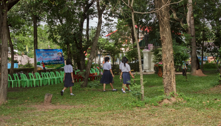 Students and people are planting trees for nature conservation in schools.Mahasarakham,Thailand,August 2016 Editorial