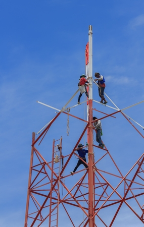 Technicians was dismantled tower the phone is due to complaints about the health of the people.Mahasarakham,Thailand,August 2016