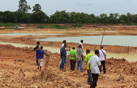 dredging tools: Engineers and the Board joint monitoring project dredging the pond in order to store water for use during the dry season.Mahasarakham,Thailand,August 2016
