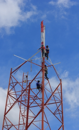 disassemble: Technicians was dismantled tower the phone is due to complaints about the health of the people.Mahasarakham,Thailand,August 2016