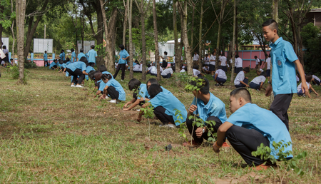 Students and people are planting trees for nature conservation in schools.Mahasarakham,Thailand,August 2016 Editoriali