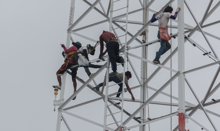 complaints: Technicians was dismantled tower the phone is due to complaints about the health of the people.Mahasarakham,Thailand,July 2016 Editorial