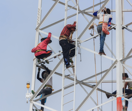 dismantled: Technicians was dismantled tower the phone is due to complaints about the health of the people.Mahasarakham,Thailand,July 2016 Editorial