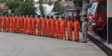 Firefighters line up to welcome guests to study visit.Mukdahan,Thailand,August 2016 Editorial