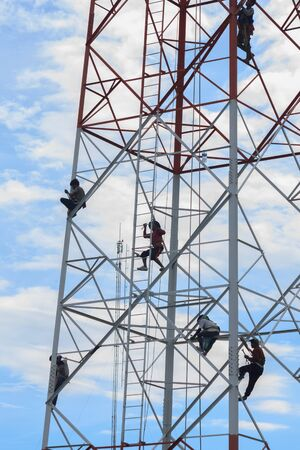 dismantled: Technicians was dismantled tower the phone is due to complaints about health problems.Mahasarakham,Thailand,July 2016