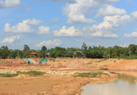 dredging: Backhoe dredging swamps for agriculture in the dry season.