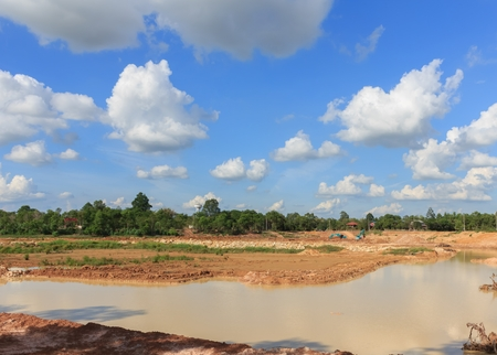 Backhoe dredging swamps for agriculture in the dry season.