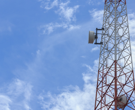 Telephone transceiver on pole with blue sky