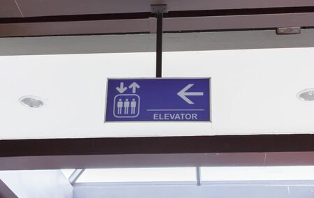 Signs to the elevator. Stock Photo