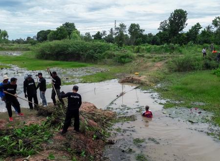 Backhoe dug weeds in canals that block the waterways.Mahasarakham,Thailand,June 15,2017