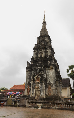 Tourists visit and worship Ing Hang Pagoda.Savannakhet,Laos,August 2016 Editorial