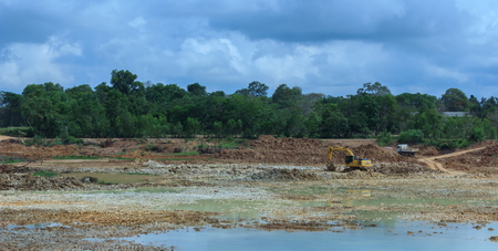 Backhoe're dredging the pond to store water for use during the dry season.Mahasarakham,Thailand,August 2016 Sajtókép