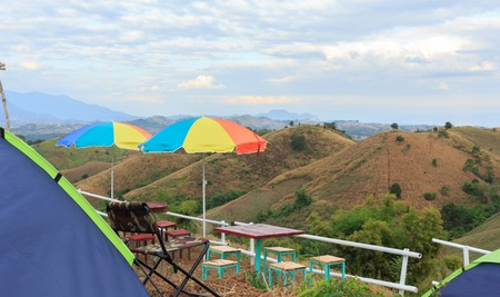 Umbrellas and dining tables for stunning mountain views.