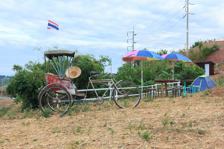 Tricycle for garden decoration. Stock Photo
