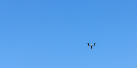 Drones flying in the sky for shooting video. Stock Photo