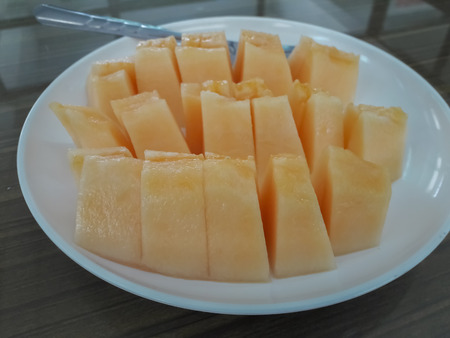Melon sliced in a plate.