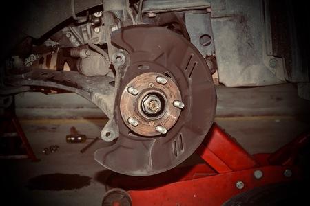 Technicians are repairing car brakes.
