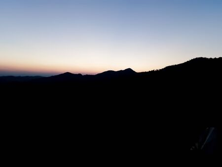 The sun rises behind the mountain in the morning. Stok Fotoğraf - 128046682