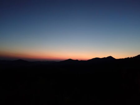 The sun rises behind the mountain in the morning. Stok Fotoğraf - 128046809