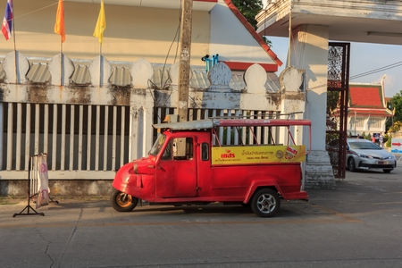 PhitsanulokThailand-November 25 2018:Tricycle Tuk-Tuk frog face waiting for tourists